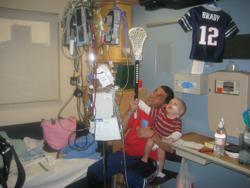 Mike and Brady Wein raise up a stick